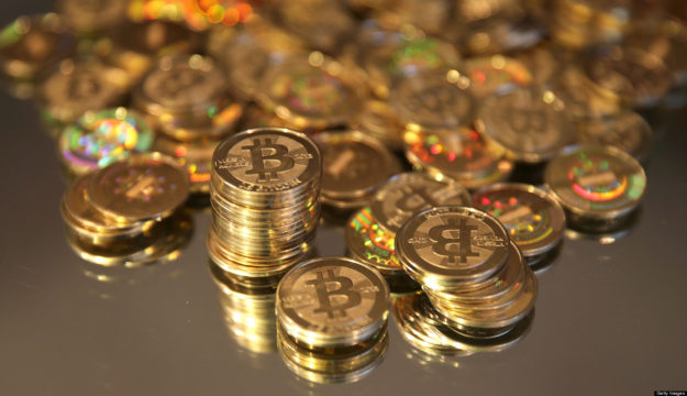 A pile of Bitcoins that were just made are arranged for a photograph in Sandy, Utah, U.S., on Friday, April 12, 2013. Created four years ago by a person or group using the name Satoshi Nakamoto, Bitcoin is a virtual currency that can be used to buy and sell a broad range of items -- from cupcakes to electronics to illegal narcotics. Photographer: George Frey/Bloomberg via Getty Images